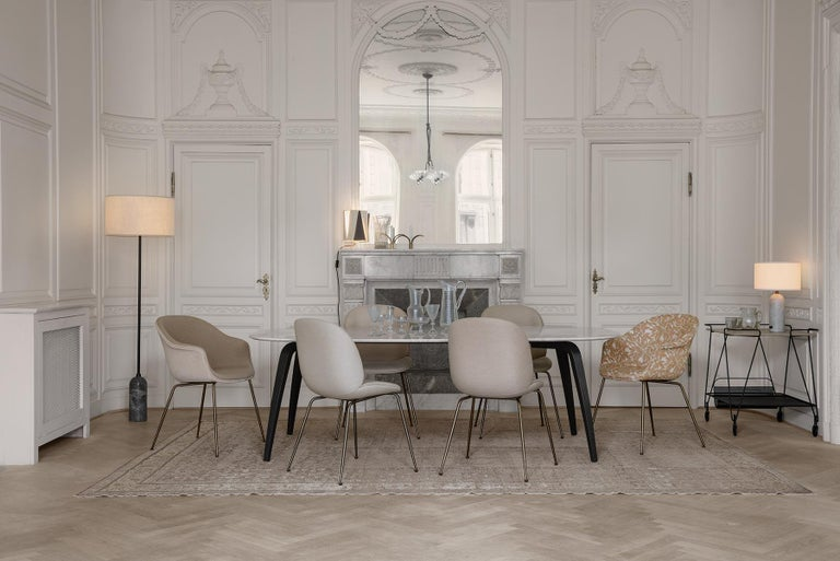 The bat dining chair, designed by Danish-Italian design-duo GamFratesi, carries strong references to the interesting characteristics of bats, with its inviting, distinctive shell reminiscent of the shape of a bat's wingspan. Balancing between the
