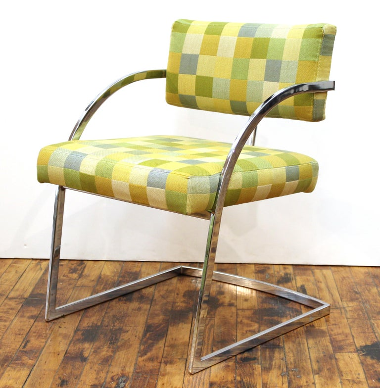 Baughman style modern set of four chromed metal dining chairs or armchairs with upholstery. Staining and age-appropriate wear to the upholstery.