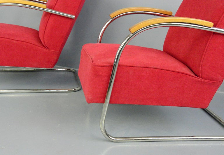 Bauhaus armchairs by Mucke Melder, circa 1930s.  - Price is for the pair - Sprung seats and back rest - Chrome-plated tubular steel cantilever frames - New red velvet upholstery - Model FN21 - Produced by Mucke Melder - Czech, 1930s -