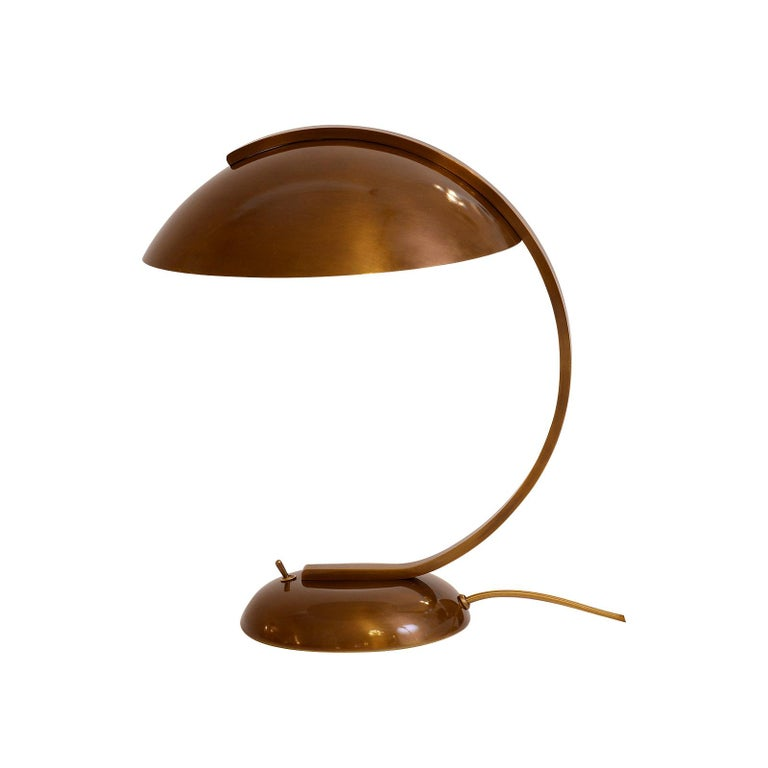 A classic desk lamp which is elegant and timeless.  Handcrafted and manufactured at the Woka workshop in Vienna.