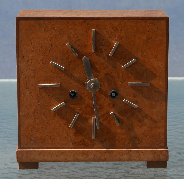Beautiful Burled case with walnut trimmed edges and brass hands and indices. 8 day clock with a beautiful movement accessible from the back, both the movement and the chime can be wound from the front. Clock can be used with or without the chime.