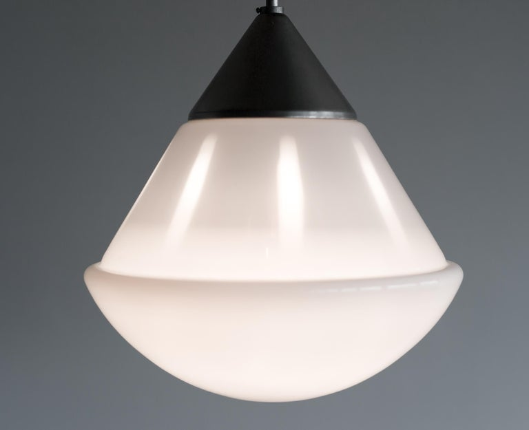 Rare large pendant designed at the Bauhaus Dessau ateliers by Marianne Brandt and executed by Kandem, Leipzig, Germany. White cased opal glass with nickel-plated brass hardware. The