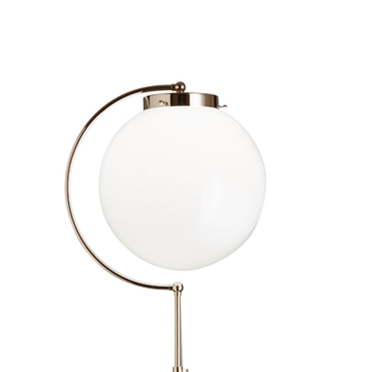 Bauhaus floor lamp DSL 23. Originally designed in 1923 by Richard Döcker. Current production manufactured in Germany by Tecnolumen. Nickel, opaline glass. Rewired for U.S. standards. Adjustable height. This floor lamp from 1923 is a clear reflection