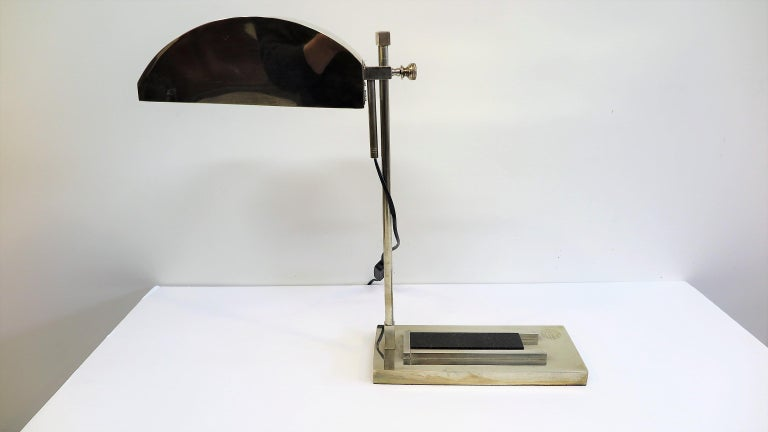 Bauhaus desk lamp by Marcel Breuer. Designed for the International Exposition of Modern Industrial and Decorative Arts, in Paris 1925, number 55 of 100. Articulating movement up and down with full 360 rotation. Composed of brass plated nickel,