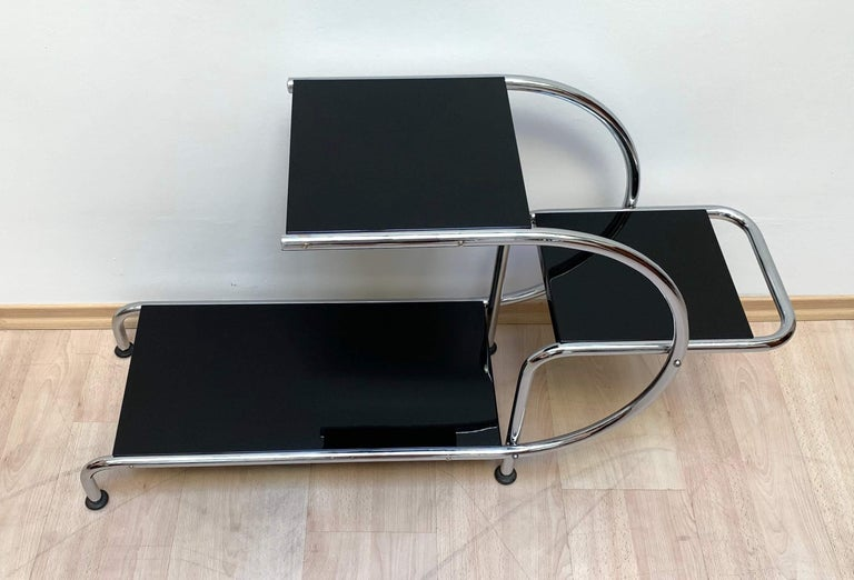 Beautiful three-storied Bauhaus steeltube étagère circa 1930  Newly galvanized (chromed) original steeltube frame and screws.  Black lacquered and polished wood shelves.  Manufacturer: Thonet Brothers (not labelled).