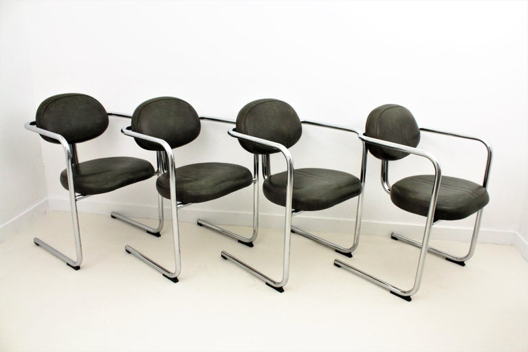Set of four tubular chromed steel and green leatherette cantilever chairs with arms in the Bauhaus style, Spain, 1960s