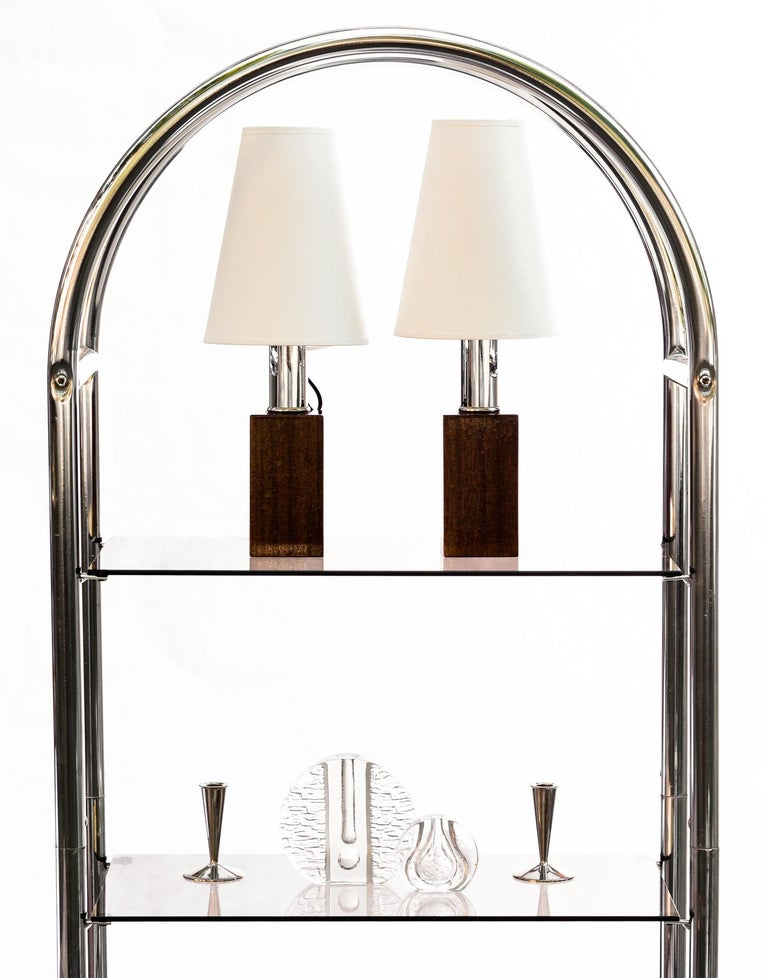 Bauhaus style bookcase, present Classic, modernist design. The rack structure is made of bent and chromed steel tubes. The bookcase has four shelves made of smoked glass.  The bookshelf is characterized by a synthetic form based on the shapes of