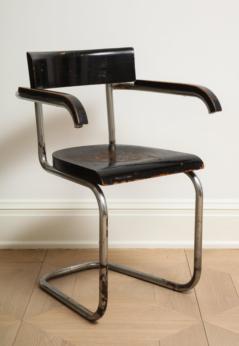 Bauhaus tubular chromed steel and ebonized beech armchair by Dutch designer Mart Stam for Thonet, 1932. The original wood finish has worn patches and there is some rust and losses in the chrome, all visible in the photos.   Measures: Arm height