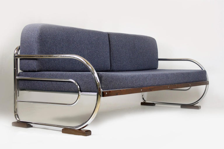 Bauhaus style sofa with a lacquered wood and chrome tubular steel frame. Manufactured by Hynek Gottwald in the 1930s. Brand new mattresses upholstered with fabric that is resistant to dirt and abrasion. Woodwork has been restored, chrome is in its