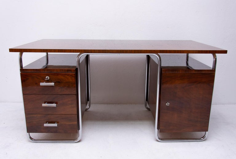 Tubular massive writing desk from the 1930s from the Bauhaus period. It was designed by legendary Jindrich Halabala for the ÚP Závody Brno. A typical example of European functionalism and the works of leading designers of this period such as Marcel