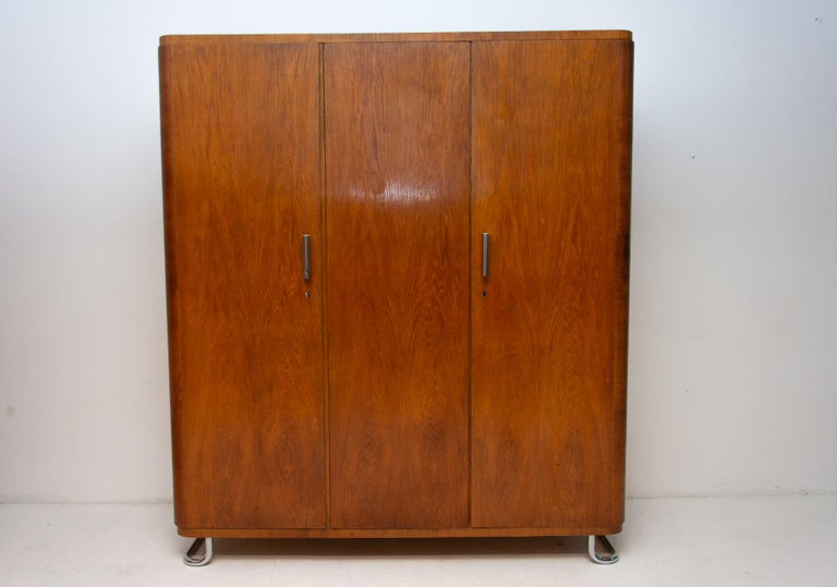 Wardrobe with chrome elements from the Bauhaus period. It was made in the former Czechoslovakia by Vichr & spol in the 1930s. This is a typical example of residential furniture from the Bauhaus period in Central Europe. Chrome is in very good