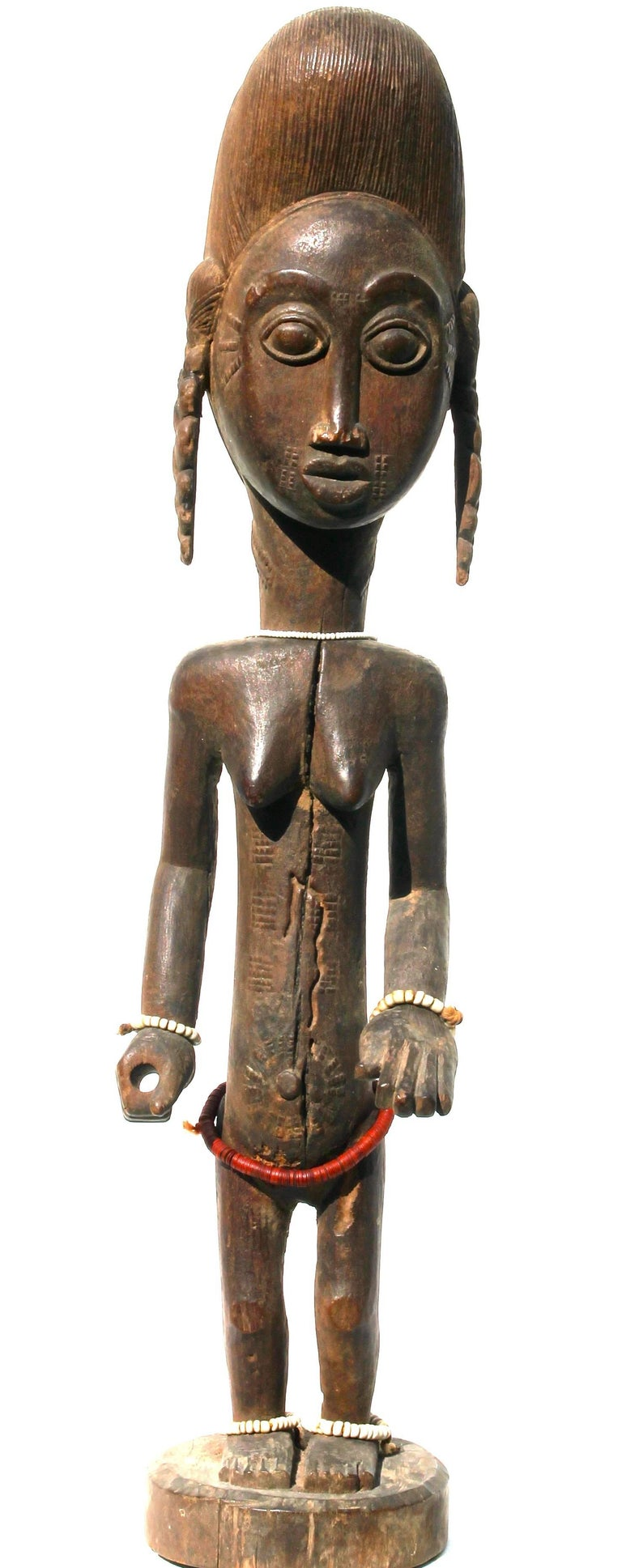 A fine Baule female figure. Provenance: The Alexander S. Honig collection of African Art, May 18, 1993, Lot: 78, Sotheby's New York.