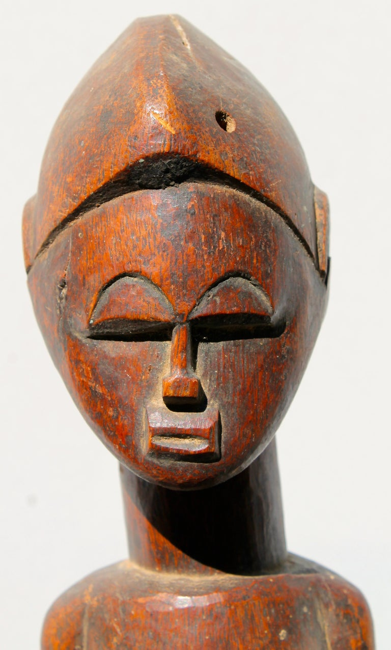 A fine old Baule carving, with a rich golden brown surface patina.