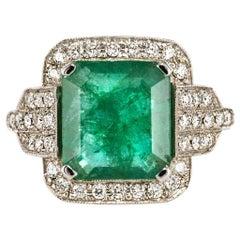 Baume 4.65 Carat Emerald Diamond Gold Ring