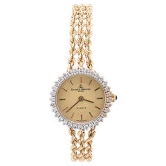 Baume & Mercier 14 Karat Yellow Gold Vintage Ladies Watch with Diamond Bezel