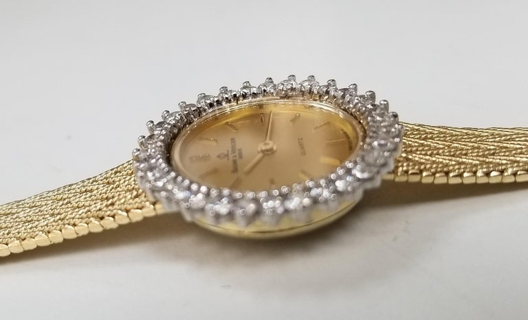 Round Cut Baume & Mercier 14 Karat Yellow Gold and Diamond Watch For Sale