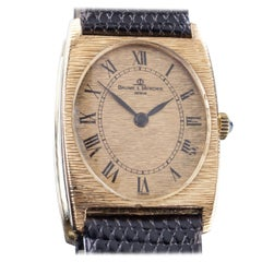Baume & Mercier 18 Karat Gold Tonneau Hand-Winding Watch with Black Leather Band