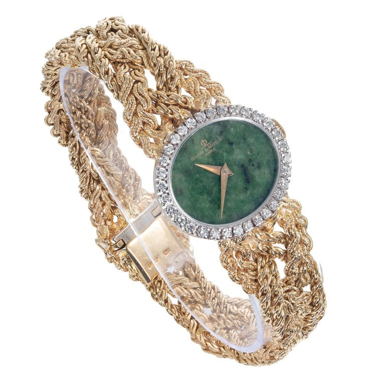 Haute Couture Baume & Mercier ladies wristwatch with a natural jade dial, diamond bezel and an 18k yellow gold case and braided band. Full original 7 ¾ Inch length.   Approximately .75 carat diamonds F VS Total weight 77.3 grams Length: