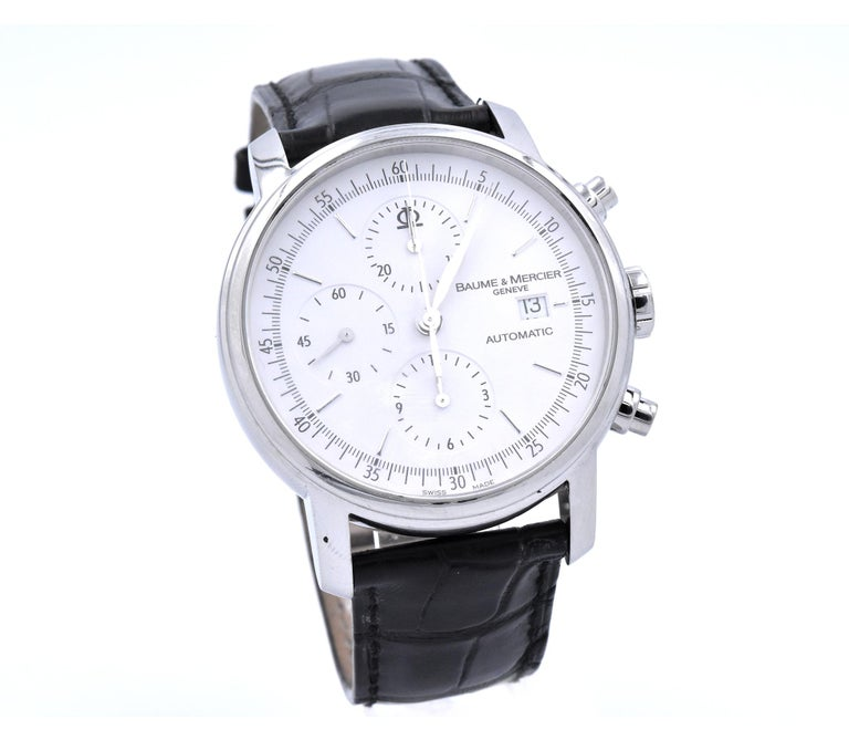 Movement: automatic Function: hours, minutes, seconds, date, chronograph Case: 42mm round stainless steel case, sapphire crystal, push/pull crown Band: black leather strap with deployment buckle Dial: white dial with stick hour markers, steel
