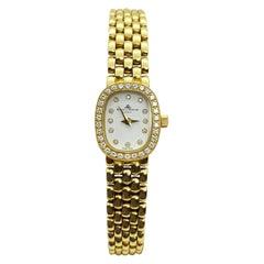 Baume Mercier Ladies 14 Karat Yellow Gold White Diamond Dial