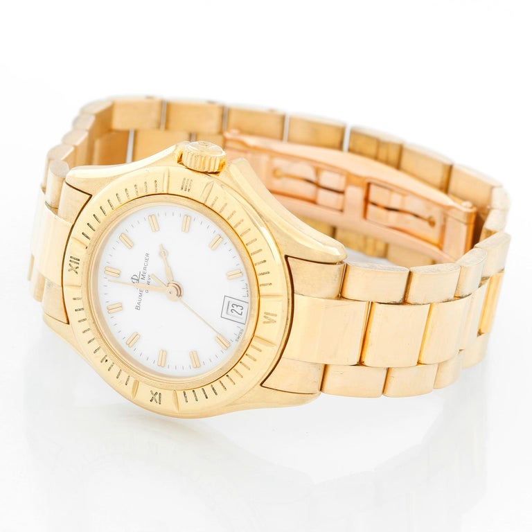 Baume & Mercier Ladies 18K Yellow Gold Riviera Watch MV045109 - Quartz. 18K Yellow gold (28 mm). White dial with stick hour markers; date at 6 o'clock. 18K Yellow gold dial with double deployant clasp; Will git a 6 inch wrist. Pre-owned with custom