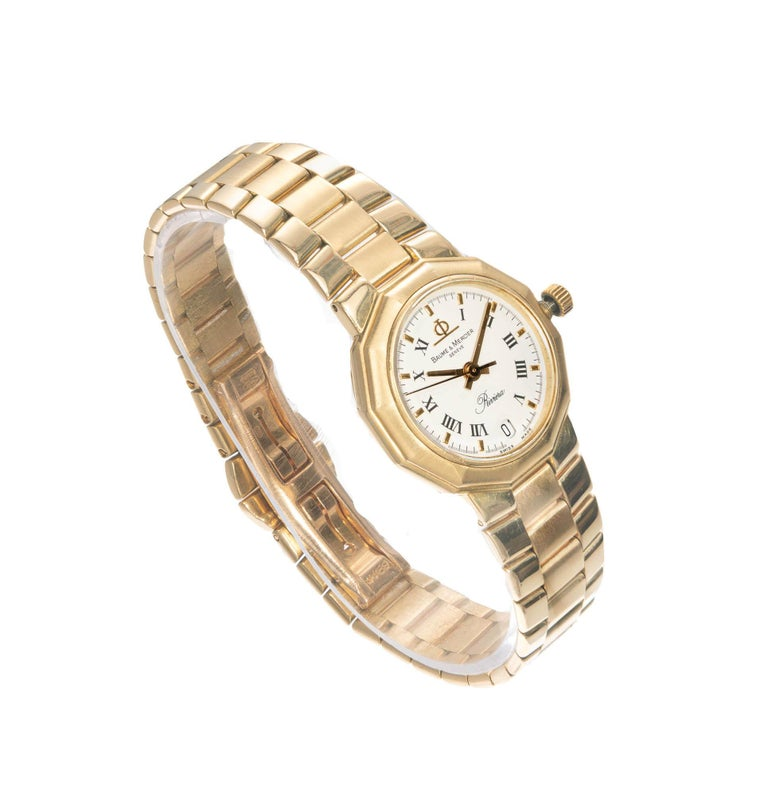 Baume & Mercier yellow gold riviera wristwatch. Solid 18k yellow gold case and band. Reliable Quartz movement, date.  Length: 29mm Width: 24.8mm Band width at case: 14mm Case Thickness: 5.93mm Band: 18k yellow gold Crystal: sapphire Dial: Eggshell