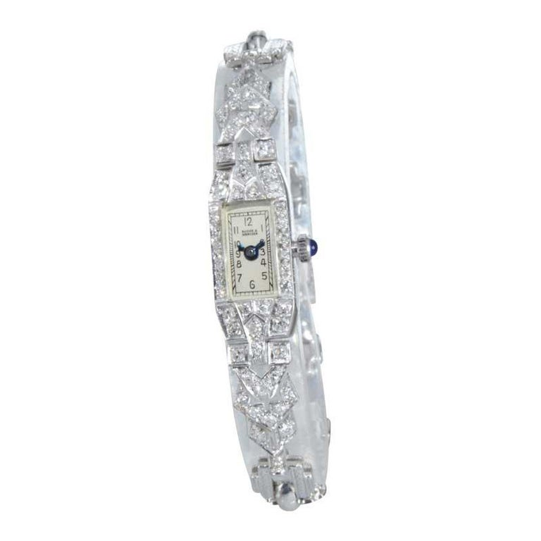 FACTORY / HOUSE: Baume & Mercier Watch Company STYLE / REFERENCE: Art Deco METAL / MATERIAL: Platinum / Diamond / Silver Rhodium Bracelet CIRCA / YEAR: 1930's DIMENSIONS / SIZE: 58mm x 10mm  MOVEMENT / CALIBER: Manual Winding / 17 Jewels  DIAL /