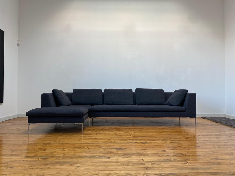 Elegant B&B Italia Charles sofa by Antonio Citterio. This sofa consists of two sections, one straight and one chaise to form a sectional. Sits on die-cast aluminum L-shaped feet. It is famous for its airy and simple profile. Dark Grey Aramis 155