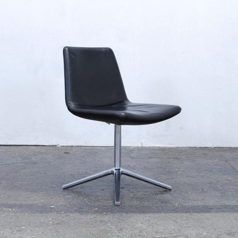We bring to you a B&B Italia leather chair set black modern bistro Swiss air lounge Zurich chrome.