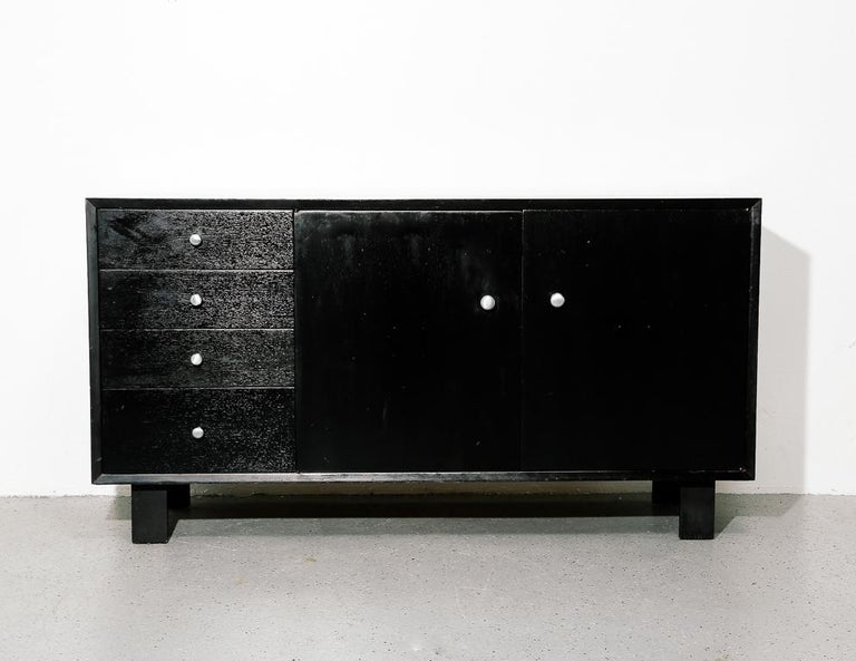 BCS cabinet or credenza by George Nelson or Herman Miller. Ebony finish with aftermarket silver pulls.
