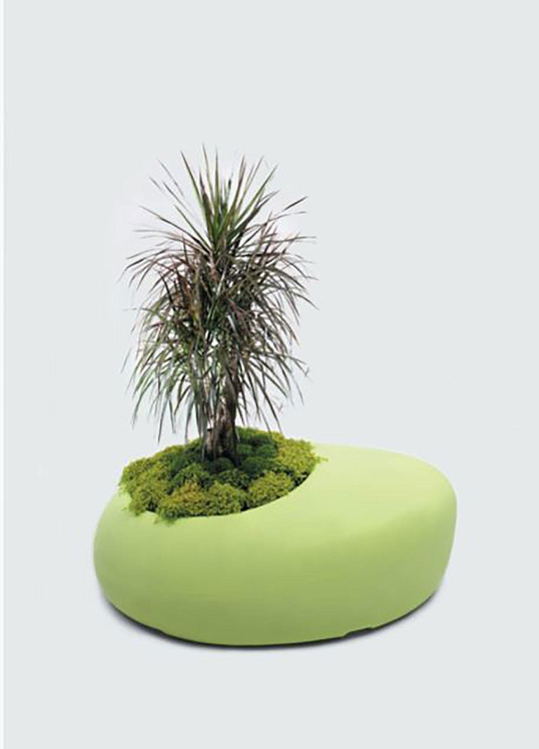 BDLove Planter designed by Ross Lovegrove for BD Barcelona. Lovegrove creates his design motivated by the philosophy and elegance of nature. The shape of this planter flows from nature and the size is considerable which makes it more combined with