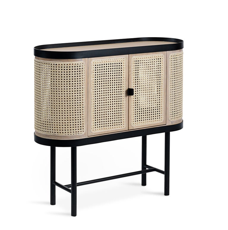 An elegant, spacious wood and wicker bar cabinet with a simple metal frame. It is an exquisite item of furniture, perfect for any connoisseur who fancies a stylish bar cabinet, or any design lover dreaming of a nice little cabinet for the living