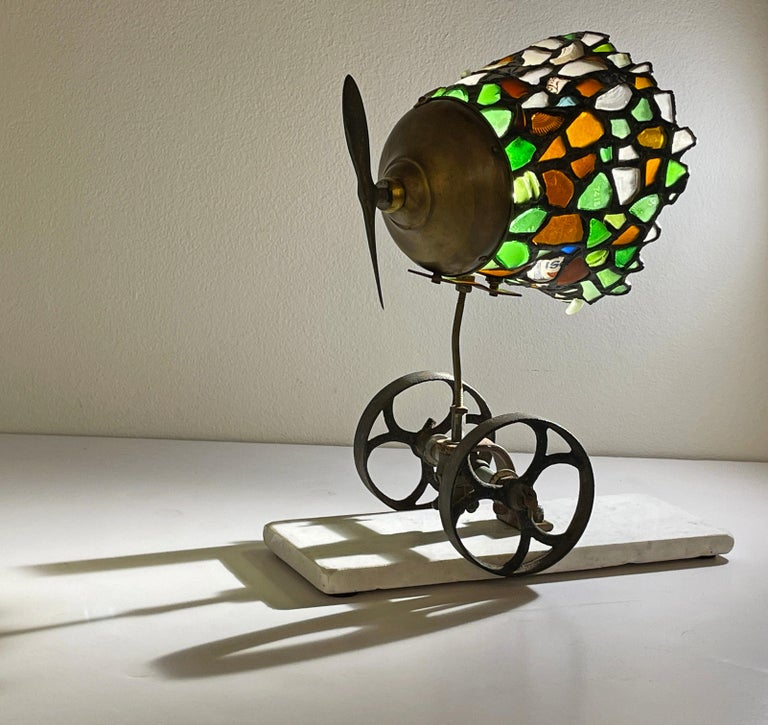 This lamp is made using salvaged Lake Michigan beach glass assembled with found objects to create this surreal and totally unique object. The artist uses the same time-honored copper foil technique employed in the creation of Tiffany lamps to obtain