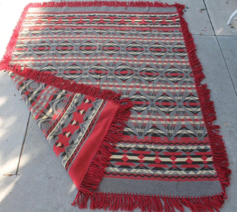 This early Beacon cotton Indian design camp blanket is in pristine condition. This was from a private collection and was never used. It retains the original fringe.