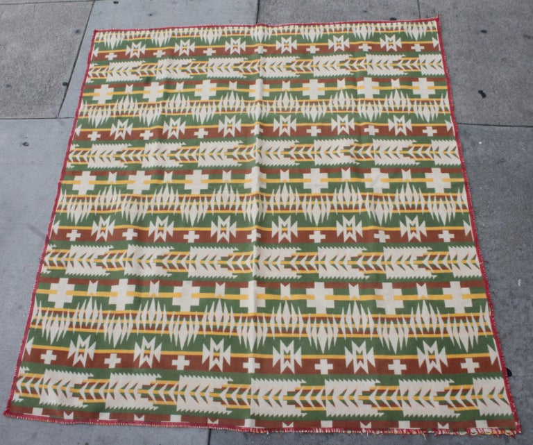 Very nice and graphic Indian design pattern and colors. Colorful and inviting cotton and beacon blanket. Great design and good wear to binding.