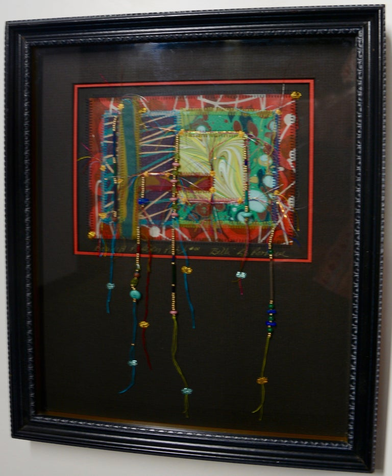 Featured is a unique mixed-media work of art by Billi R.S. Rothove. It is titled