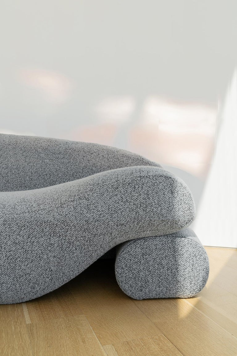 The Beanie Sofa is a comfortable textile covered sofa whose seat is comprised of one long bean bag. The sofa incorporates daybeds facing opposite directions. Its soft structure is filled with organic latex and lentil beans, which support the natural