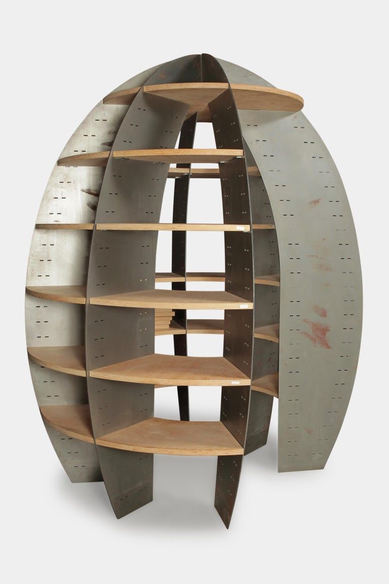 A very rare walk-in library designed by Beat Frank. Seven metal elements, laser cut, matte grey finish, shelves made of birch plywood, matte varnished, iron plates, height 234 cm, inside height 206 cm, diameter 195 cm, inner diameter 90 cm. This