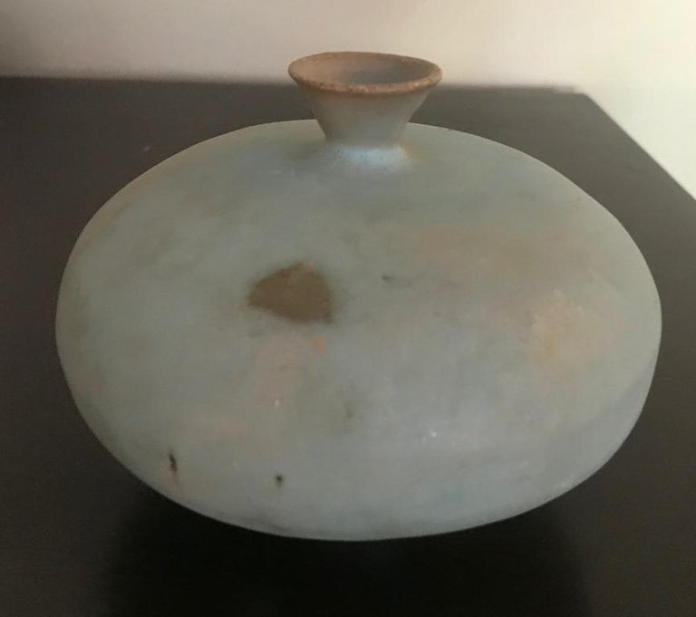Fantastic piece. Rare shape. Beautiful light blue sumptuously dripped glaze.   Signed and notated by the artist on underside of base.  Would be an amazing addition to any collection and sure to stand out.  Know famously in the arts world as