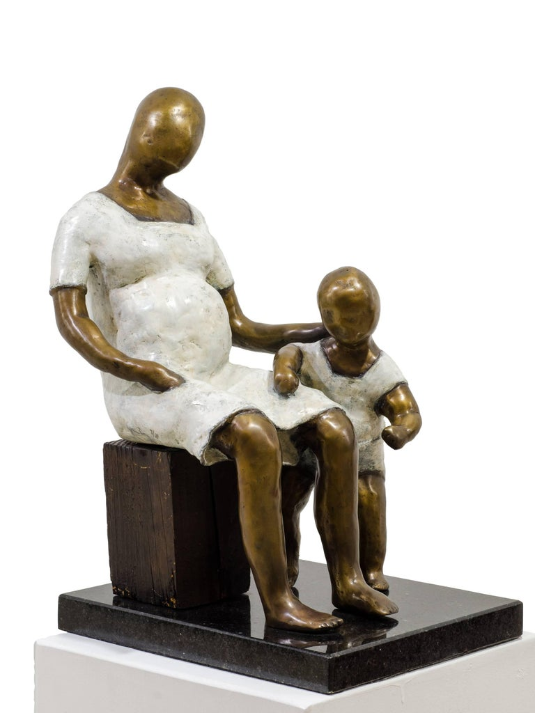 Awaiting. Bronze sculpture with white and golden patina by Beatriz Gerenstein