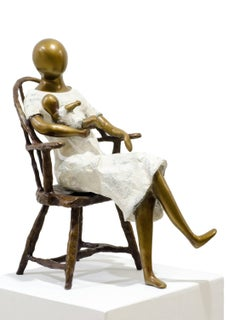 Mother in chair.