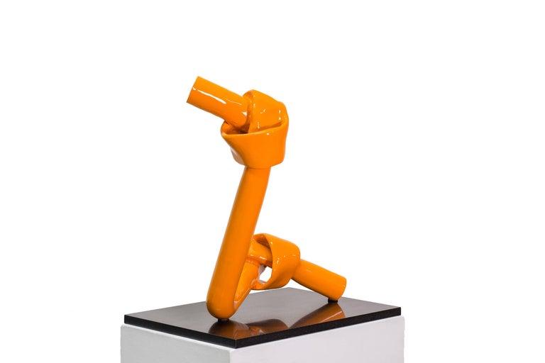 Simply Together. Bronze sculpture, bright orange patina by Beatriz Gerenstein