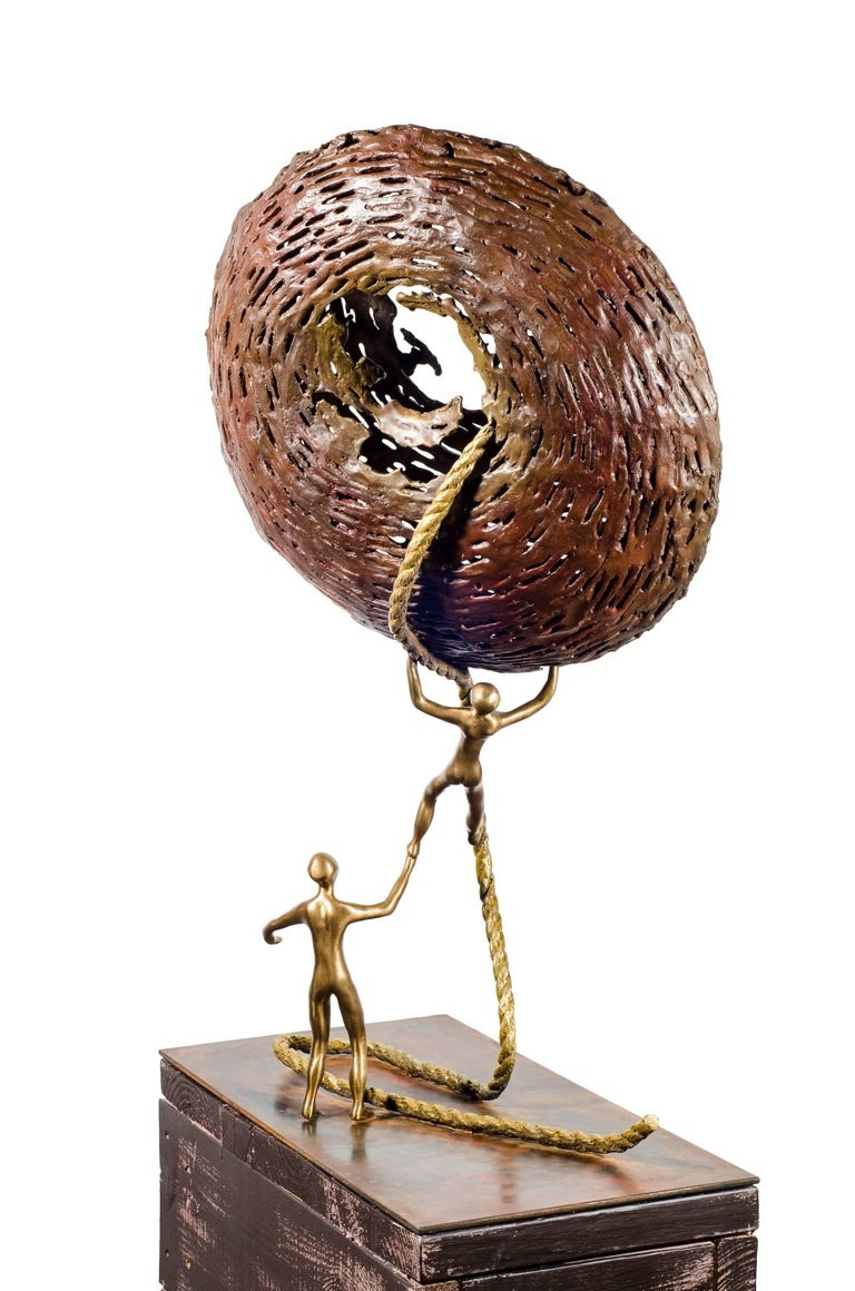 With Help is Better. Bronze sculpture with golden patina by Beatriz Gerenstein