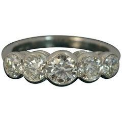 Beautiful 1.75 Carat Diamond Five-Stone Platinum Bezel Set Stack Ring