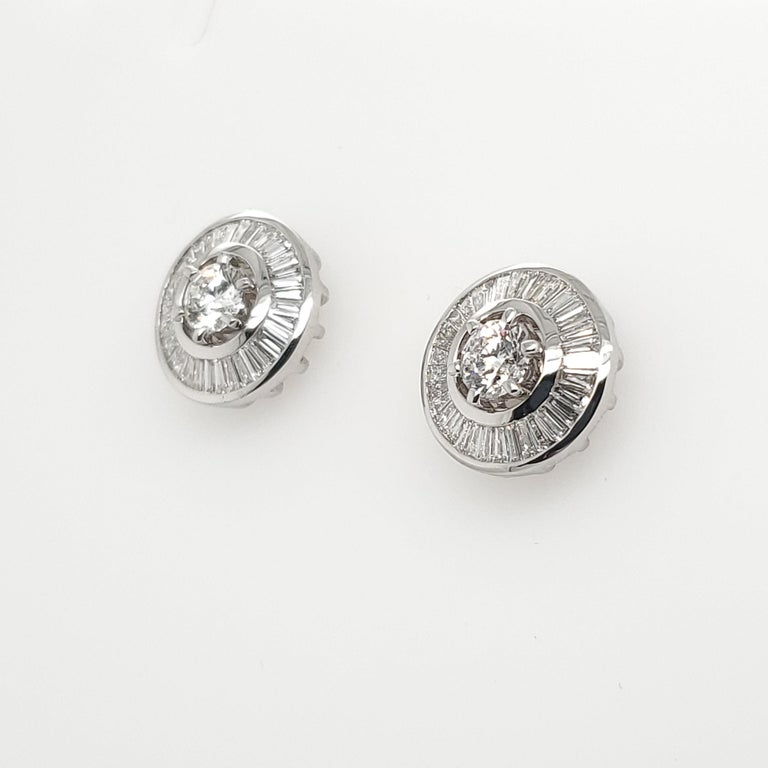 Two in One handcrafted pair of Diamond Stud Earrings, with add on Baguette Diamond Jacket, that can be removed and add on.  Round Brilliant Cut White Diamonds totaling 1.09 ct F-G Color, VS Clarity Baguette Diamonds totaling 1.18 ct G-H Color and