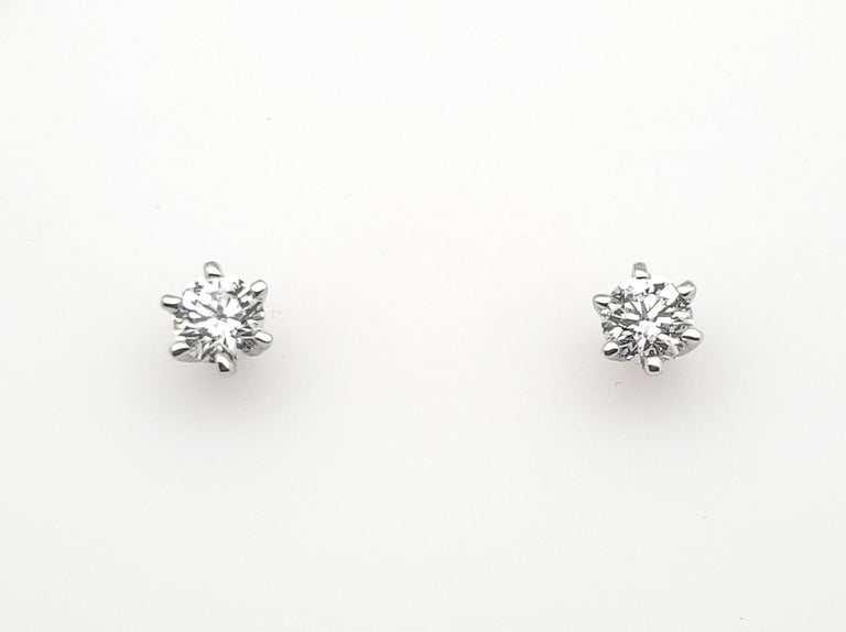 Round Cut Beautiful 18 K White Gold Solitaire Diamonds Studs with Baguette Jackets 2.27 ct For Sale