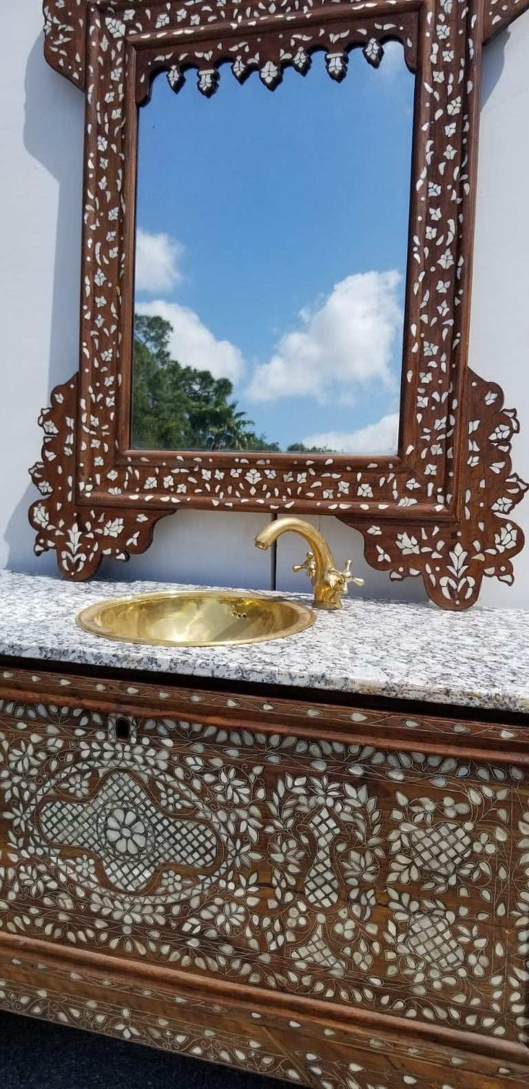 Beautiful 19th century Middle Eastern mother of pearl vanity and mirror. Old Syrian wedding chest Re- purposed into a sink vanity and mirror set. The chest is walnut and mother of pearl with a beautiful matching mother of pearl mirror. Measures: