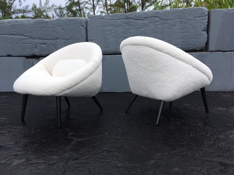 Original 1950s lounge chairs, faux sheepskin and black painted wood legs. Faux sheepskin is new and in great condition. Each chair comes with a pillow. Please see all pictures.