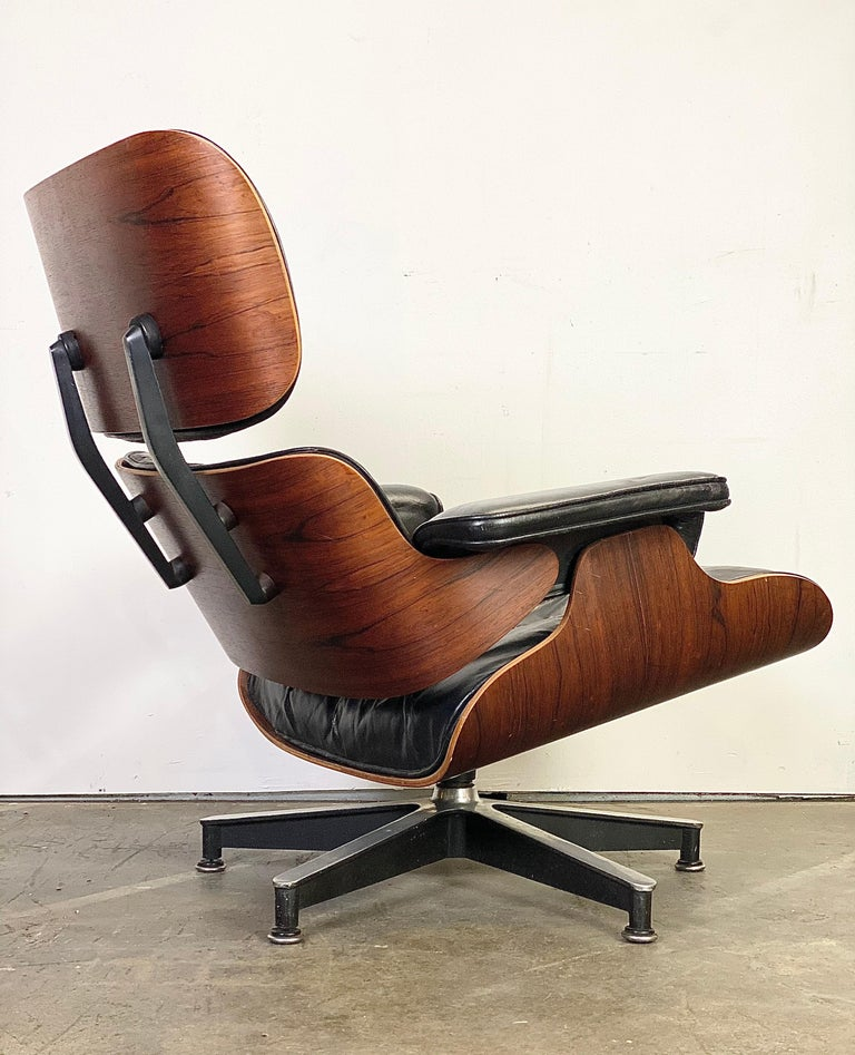 A Classic Eames lounge chair and ottoman executed in gorgeous rosewoood and black leather. The depth of color and textured grain patterns are gorgeous and the wood has been cleaned and oiled. The leather has also been tuned up but it maintains