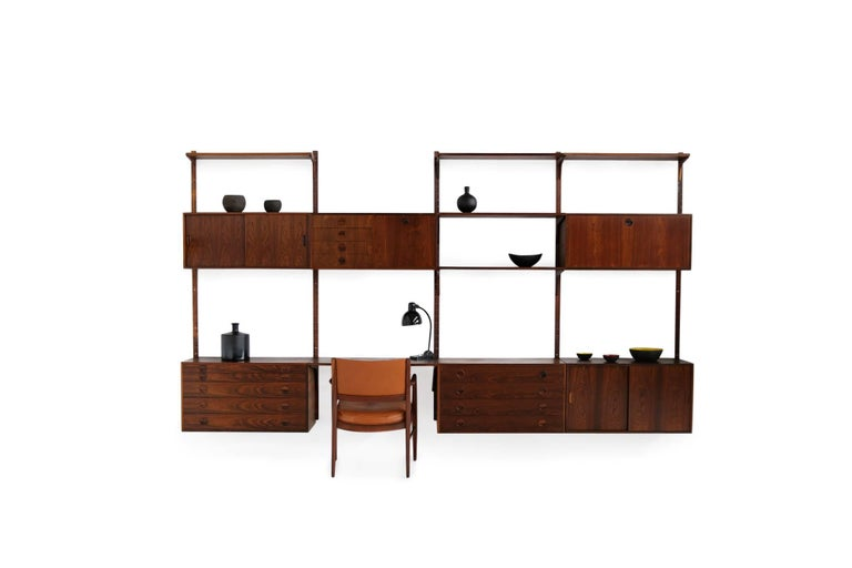 Beautiful and large 1960s wall unit, by Rud Thygesen & Johnny Sorensen for HG Furniture Denmark. Very good condition, super rare and beautiful. Modular shelving system, the cabinets and shelves can be arranged a desired. Overall 360 x 200 cm like on